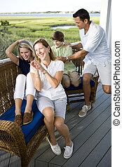 Happy family with two teenagers on terrace