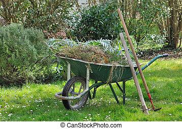 garden weeds in wheelbarrow