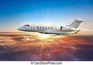 Private jetplane flying above clouds in sunset - Private...