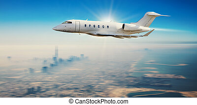 Private jet plane flying over modern city with skyscrapers
