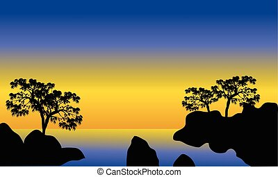 Silhouette of sea and rock