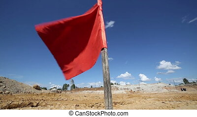 The red flag in the open mine