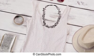 White dress and beige sandals. Simple dress on white...