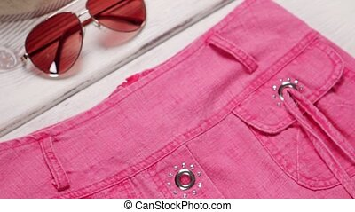 Aviator sunglasses and pink garment Womans pink garment on...