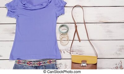 Light purple t-shirt with skirt. Plain female clothes on...
