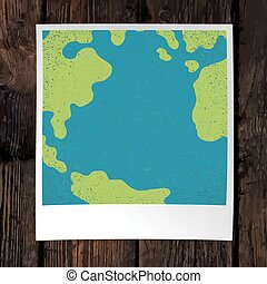 Photo frame with Earth snapshot closeup. Earth day concept. With space for text. On wooden background. Design template.