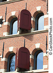 Historic dutch facade, windows with shutters - A historic...