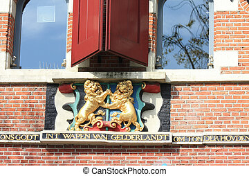 historic plaque with coat of arms - A coat of arms shown in...