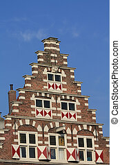traditional dutch crow stepped gable - Windows with shutters...