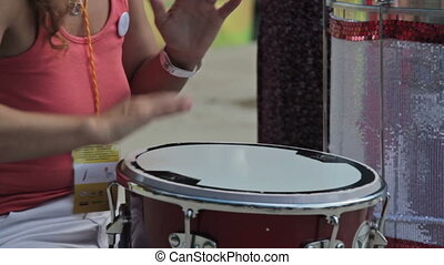 Drummer playing bongo drums at natire