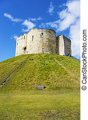 Clifford Tower in York in England. Clifford Tower is a...