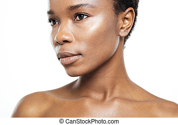 Beautiful afro american woman looking away - Cropped image...