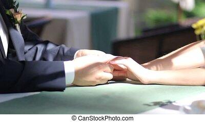Wedding gentle hand on the table