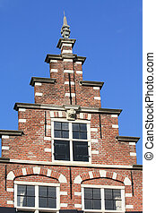 traditional dutch crow stepped gable - A tradition facade in...