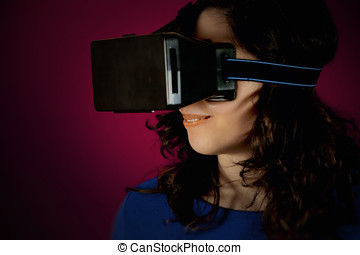 Virtual reality girl headset 01 - A girl wearing a virtual...