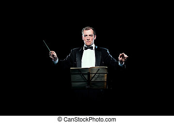 Studio photo of music conductor holding his baton - Studio...