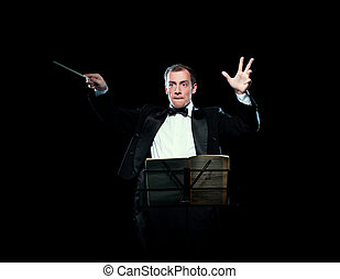 Shot of music director conducting with inspiration - Studio...