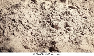 Fine Powder In Strong Light Rotates - Powder surface in...