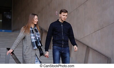 Young smiling woman and her serious handsome boyfriend...