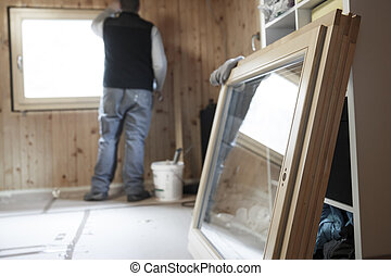 Worker installing new window