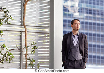 Stylish creative businessman in city looking thoughtful -...