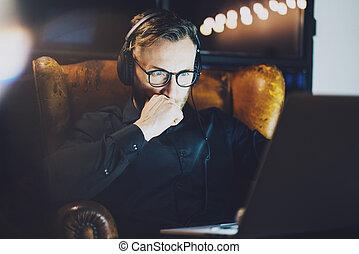 Picture bearded man wearing glasses working modern loft...