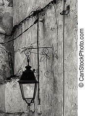 Old lantern in wrought iron. - Black and white image of old...
