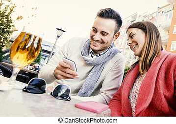 Couple drinking beer in a bar