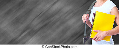 Hands of young student girl with a book. - Hands of young...