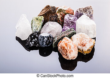 semi precious gems - close up shot of a heap of different...