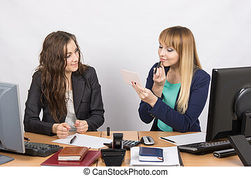 Office employee observes as lipstick colleague sitting...