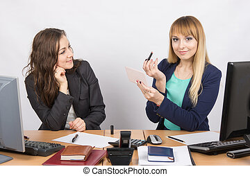 Office employee at his desk looking at his colleague, who is...