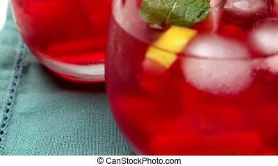 Cold strawberry drink with fresh strawberries and lemon on...