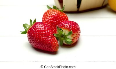 Strawberries in a small basket and