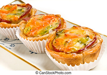 Vegetables Quiche in tray - Group of homemade mini quiche of...