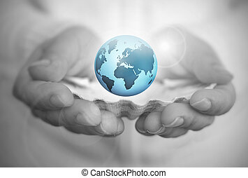The world is your oyster - Hand holding oyster shell with...