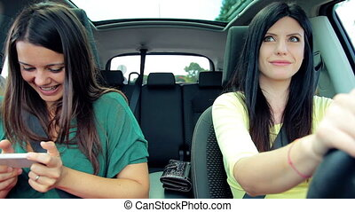 Women texting message in car - Women texting message with...