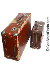 Two old brown fiberboard suitcases, isolated on white...