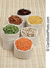 Set of various pulses in linen pouches