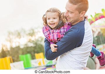 Father and daughter having fun, fun fair, amusement park -...