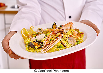 Plate of pasta and lobster served by cook - Single oval...