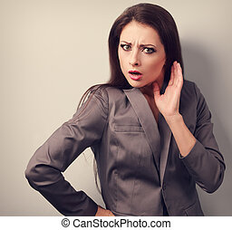 Surprising angry business woman with hand near face Toned...