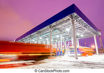 gas station at oil refinery factory night time