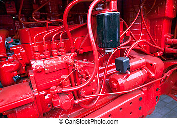 Internal combustion engine for a tractor at factory - red...