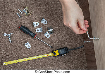 Key furniture screws, hand screwed wooden board with hex...