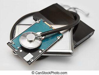 external hard drives and stethoscope on white background...