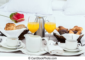 Room service with breakfast tray. - Close up of continental...