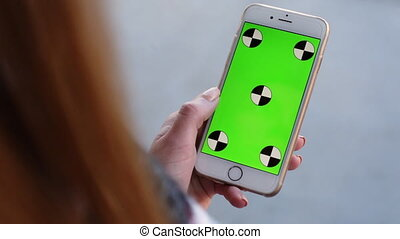 Smart Phone held by woman hands. Green screen Chroma Key....