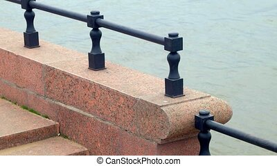 Close up view at granite Volga river embankment and water...