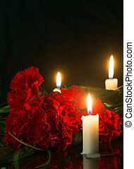 candles and red flowers